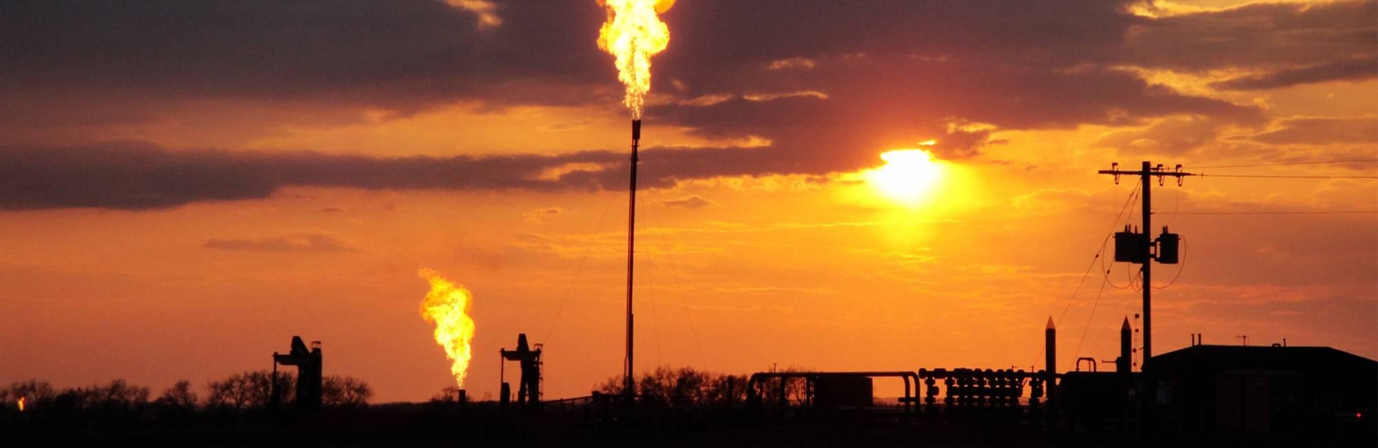 Methane flaring from a Bakken Field, North Dakota well site in 2014.